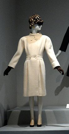 """From the exhibition titled """"Hubert de Givenchy"""" at the Thyssen-Bornemisza museum in Madrid. It's identical, except for the buttons and color to the one worn by Audrey Hepburn in """"Breakfast at Tiffany's,"""" shown below.--CH"""