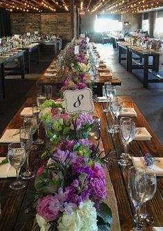 Elegantly rustic indoor wedding reception with purple and white flowers; Via Smoky Hollow Studios, Featured Event Planner: Rustic Events