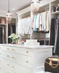 walk-in closet. - dresser in the middle