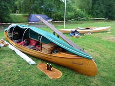 I like this idea. It shouldn't be too challenging to set up a few poles to arch across the center of the canoe, from gunwale to gunwale, and the cover it with a tarp. Keep the bugs out, maybe, and let me sleep right in the canoe.
