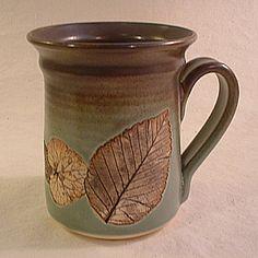 Large, clay mug, with leaf imprints.