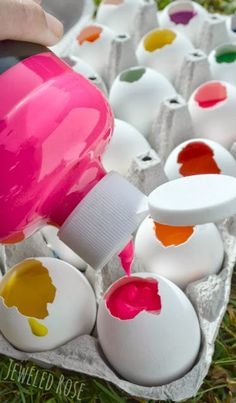 Fill eggs with paint and toss them at canvas!  This project is surprisingly easy to set up and SO FUN!