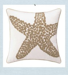 Starfish pillow. Starfish design forms a subtle and textural pillow. Sand hued knot embroidery creates a subtle beach style against the white, providing the perfect beach summer accent for any home style.