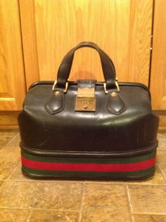 Auth Vintage GUCCI Black Leather Doctors Bag w/Combination Lock by Centerprize on Etsy https://www.etsy.com/listing/154378932/auth-vintage-gucci-black-leather-doctors
