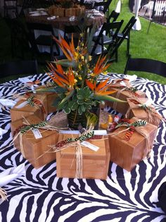 safari table decoration with a jungle theme zebra print tablecloth and favor boxes for a bridal shower