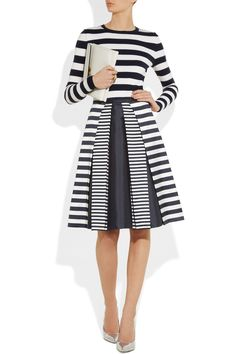 work the show styling from head to toe with a graphic sweater and pointed pumps.