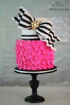 Hot pink and black cake  www.tablescapesbydesign.com https://www.facebook.com/pages/Tablescapes-By-Design/129811416695