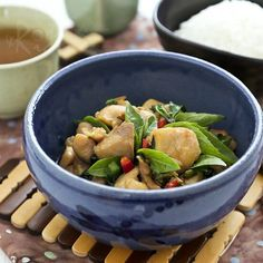 Spicy stir fry Thai Basil Chicken with basil leaves and chilies. Takes only minutes to prepare. Delicious with steamed rice.