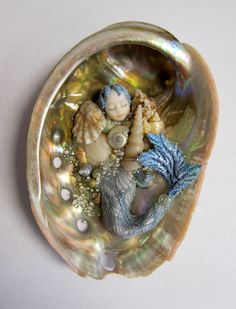 tiny mer-baby in shell
