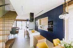 Modern Residence in Poland Highlights Floor-to-Ceiling Bookcase - https://freshome.com/modern-residence-Poland/