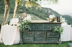 Old dresser for a bar. Best.  Glamorous Malibu Wedding: Sarah + Brendon Urie