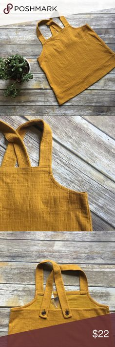 NWT Madewell Cross-back Apron top Yellow size L NWT Madewell Cross-back Apron top Yellow size L. Gauzy cotton fabric. Comes with extra button. Madewell Tops