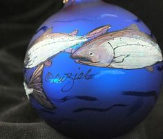 I start with a large 3-1/4 inch diameter blue glass ball ornament manufactured in the USA. I use acrylic paints and mediums, to create the design.  Elegant and sophisticated, this ornament represents some of my best work. I have painted four sparkling silver Chinook king salmon and schools of herring swim through rippling water around this velvet blue ball. This makes a great Christmas gift, especially the fishing enthusiast...the guys love this one!  I do another version of this that I...