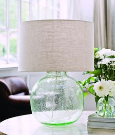 Gorgeous, hand blown organic shaped aqua-green recycled seeded glass lamp. Every single lamp is just slightly different with individual glass blowing.