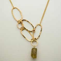 Assymetrical Statement Necklace of 14k gold fill and rutilated quartz. $125.00, via Etsy.