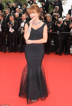 Working it: She perfected a series of poses on the red carpet as she commanded attention...