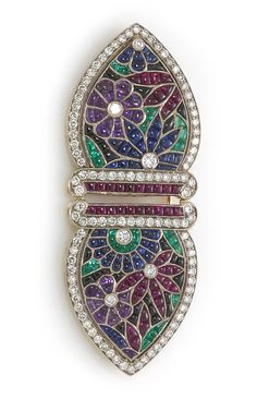 A diamond and gem-set floral motif double-clip brooch  composed of buff-topped rubies, sapphires, emeralds, amethysts and black onyx with round brilliant-cut diamond borders; estimated total diamond weight: 2.10 carats; mounted in platinum-topped eighteen karat gold