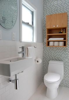 bathroom remodel for small spaces. I like this ikea sink and love the blue and white tile. I just hate the idea of cleaning the grout.