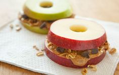 A healthy snack option for the office! Apple Sandwiches with Granola, Chocolate Chips and Peanut Butter. Leave apple rings in 7Up for 5 mins to stop them browning. *AG