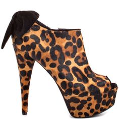 Be on your fashion game with the Raurie 2.  A soft leopard print fur blankets the silhouette while a large bow adorns the back.  Giving this sexy ankle boot a boost if a 5 1/2 inch heel and 1 1/2 inch platform.
