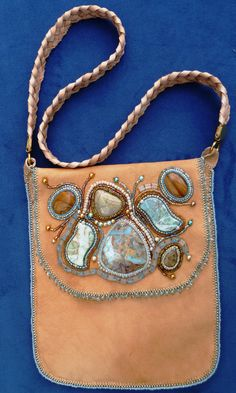 This is a beautifully bead embroidered caramel colored real leather purse/handbag, fully lined with leather and linen and fastened with a magnetic