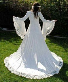 Beautiful long wedding gown with flowing sleeves