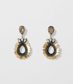 Crystals create a burst of modern opulence in these drop earrings