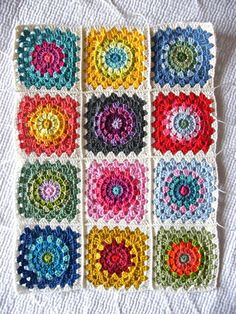 Happy Flower Block (tutorial) by Annie's Place. Such a lovely square and the colours for each are just perfect!