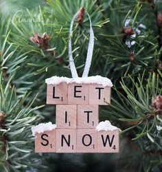 Add the title of your favorite Christmas tune to your tree by using Scrabble tiles. Get the tutorial at Crafts by Amanda.    - CountryLiving.com