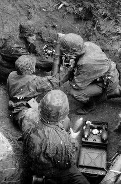 A Waffen-SS 8 cm GrW 34 mortar team in a firing position