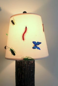 I hot glued fake bugs to a lamp shade for my son's bug themed bedroom. The rest of the room can be seen here: http://www.myjewishhome.com/ns/jacks-bug-themed-bedroom/