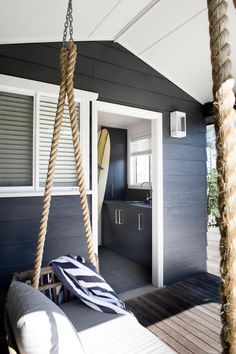 i have always wanted a porch with a swing, and this one is especially cool. interior design: karen aker. via: http://style-files.com/2013/11/14/a-casual-beach-house-in-australia/