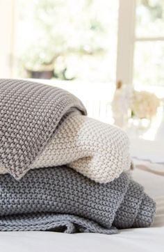 Cozy throw blankets for fall or winter in white, beige and grey from Crane & Canopy.