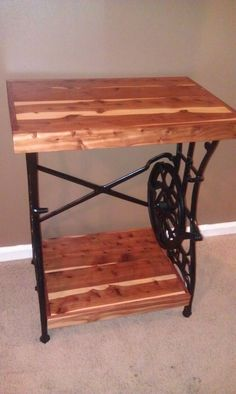 Table made from old sewing machine stand... not sure if I want to keep the presser foot or add another wooden shelf