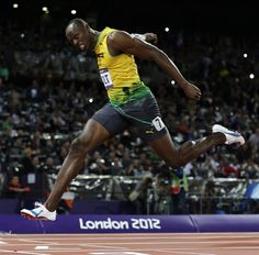 Usain Bolt crosses the finish line to win gold in the 100 Meter Final!