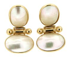 These dangle earrings are made from solid 14k yellow gold. They are set with 2 Pearls each. The top Pearl of each earring measures approximately 13.67mm x 20.73mm. The bottom Pearl of earring measures approximately 20.43mm x 13.39mm. The earrings weigh 11.3 grams.