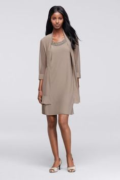 Go for a look and feel that is timeless and chic in this modern Mother of the Bride or Groom dress! Sleeveless short jersey dress with eye-catching beaded neckline and 3/4 sleeve sheer illusion jacket. Designed by R&M Richards. Fully lined. No zipper. Imported polyester/spandex blend. Hand wash cold gently, no bleach. Lay flat to dry. Cool iron on reverse side if needed. Do not apply heat or steam to trim.Also available in Plus sizes as Style 8442W