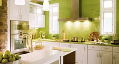 love this shade of green with white cabinets. I'll have butcher block countertops in a light wood with black handles and maybe yellow and orange accents?