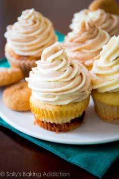 Snickerdoodle Cupcakes with a gooey cinnamon-swirl filling, topped with Cinnamon-Swirl Frosting. Yes, SO good..