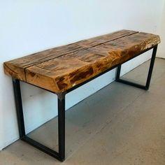 Reclaimed barn beam bench on raw steel frame by barnboardstore.com