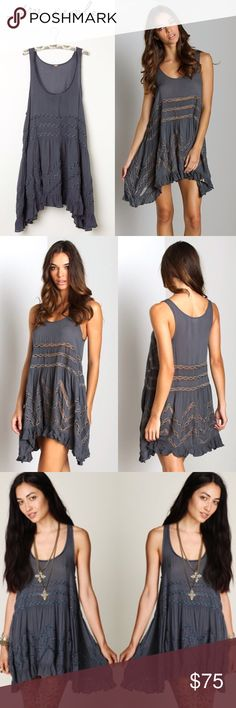 NWOT Intimately Free People Voile Trapeze Storm Embrace your inner little girl; this tunic-dress will totally inspire you to skip, twirl & maybe even make daisy chains for all of your best friends. * Delightfully dainty. * Detailing: Micro polka-dots all over; lace detailing throughout & 2-inches ruffle along bottom * Scoop Neck * Sleeves: 1-1/4-inches wide * Silhouette: 25-inches side-seam from underarm to bottom hem * 100% rayon * SIZE MEDIUM * BRAND NEW WITHOUT TAGS - ONLY WASHED Free…
