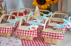 Miniature picnic baskets -- filled with small jars of jam and a small bag of candy --act as party favors...
