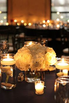 really like the low flowers and the candles around, especially with floating candles above other flowers
