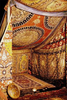 Textile tent - oh my, I'd love to do this with huge rugs in the backyard for a Moroccan theme party! And tons of huge floor pillows.