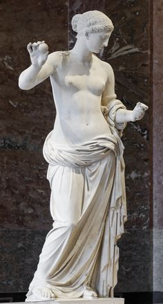 Statue of Aphrodite, known as the Venus of Arles. Hymettus marble, Roman artwork, imperial period (end of the 1st century BC), might be a copy of the Aphrodite of Thespiae by Praxiteles. The apple and the mirror were added during the 17th century. Found in the antic theatre of Arles, France. Louvre Museum.