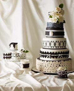 Black & white wedding cake with mini cakes to match // Photo: Philip Ficks // http://blog.theknot.com/2013/09/25/10-amazing-new-wedding-cake-ideas/
