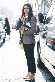 A Peter Pan-collar blouse is paired with a plaid blazer, cropped jeans, Valentino heels, a Louis Vuitton clutch, and a rope keychain