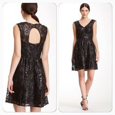 Stunning lace and sequin dress Delicate black lace and sequined filigree A line dress. Has cap sleeves and open back. Decode 1.8 Dresses