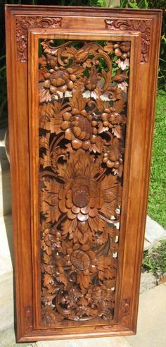 ** I like this, it makes me smile for some reason... Hand Carved Floral Wood Panel