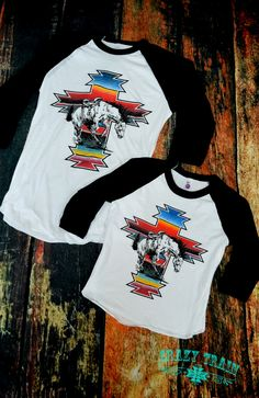Dress her up in Southwestern style in our Kids War Paint Rodeo Baseball Tee from Crazy Train Clothing. Soft and quality made, this is destined to become her most favorite shirt! Trendy and unique, mak